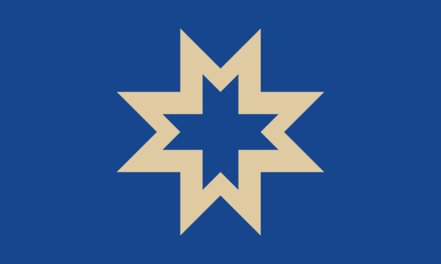 "The ""M"" Star (DeChazier Stokes-Johnson) Four ""M""s connect to form a cream-colored star representing Milwaukee on the blue lake, its Native American roots, unity, and signifying the city's bright future."