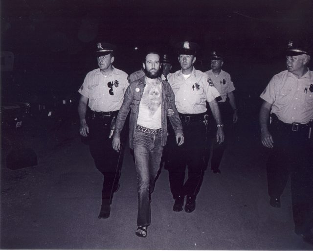 """CARLIN: Carlin's 1972 arrest at Summerfest, for his bit about the """"Seven Words You Can't Say on Television,"""" was a landmark in Carlin's career and in modern comedy. 1972 Photo of George Carlin during that arrest. (Photo credit: Mark Goff)"""