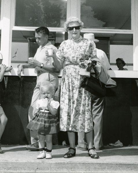 Woman in sunglasses drinking milk