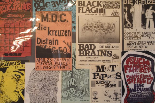 """Show posters found on the upper floor of the exhibit advertise """"all-age"""" and various punk shows."""
