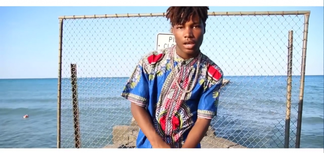 Artist Tyrone King stands on the shores of Lake Michigan in True Skools video for 'Liquid Gold.'