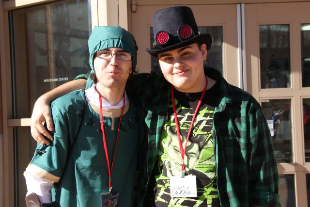 Cosplayers Simon Thibadu and John Drinkwater enjoy the sunshine outside of the convention center.