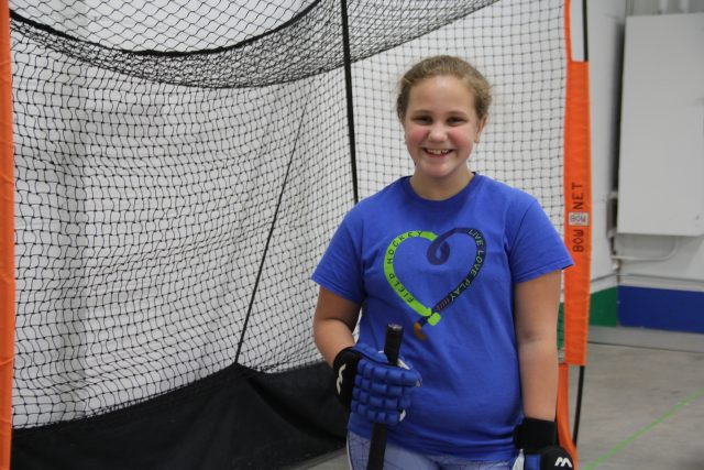 Sixth grader, Leslie Lamanczek, smiles during Thursday-night practice at LIFTs space in Glendale.