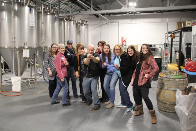The Angels pose after their March meeting at Black Husky Brewing in Riverwest.