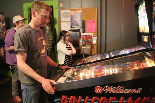 Rob Anderson and Karlee Royek step in to play a game during the monthly pinball tournament at Riverwest's Bremen Cafe.