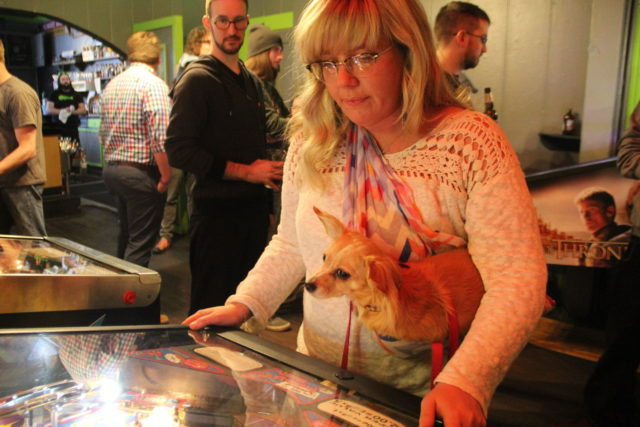 Jessica Anderson and Tuesday the dog pinball for first while competitor Michael Ritter checks out the competition.