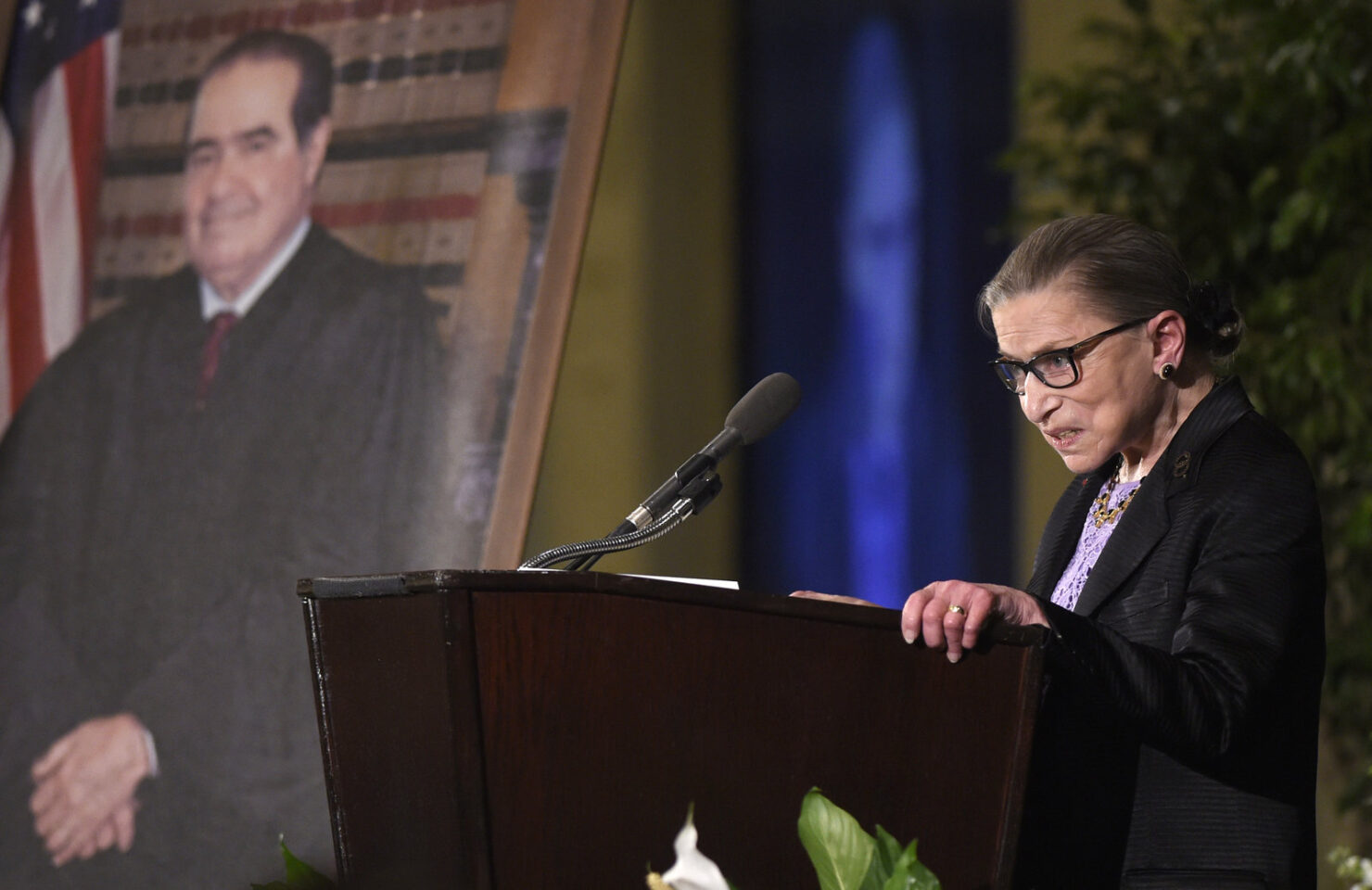 Ginsburg speaks at a memorial service for Supreme Court Justice Antonin Scalia at the Mayflower Hotel in Washington in March 2016. Susan Walsh/AP