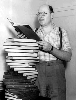 "Carlton E. Morse poses with the many scripts he wrote over the years for ""One Man's Family""."