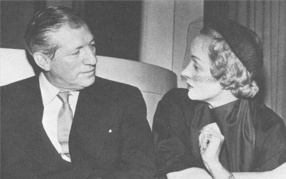 "Howard Dietz chats with Marlene Dietrich during a break from rehearsing ""The MGM Theatre of the Air""."