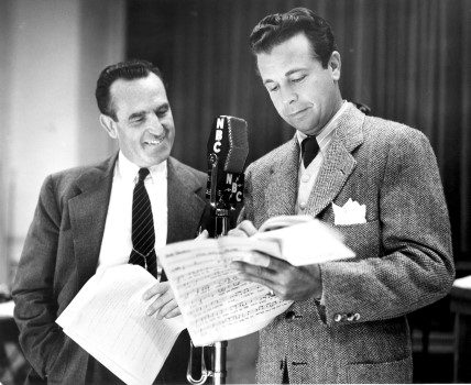 "Lloyd reviews the script for ""True to Life"" with singing star Dick Powell."