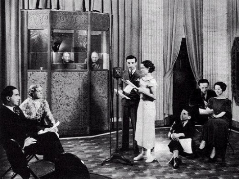 "The case of ""One Man's Family"" gathers in a radio studio for a broadcast in the early 1930s. That's Carlton Morse to the right in the audio booth."