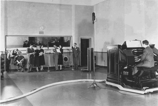 "In a photo taken in the mid-1940s, the ""One Man's Family"" rehearses for a broadcast, accompanied by the NBC studio pipe organ."