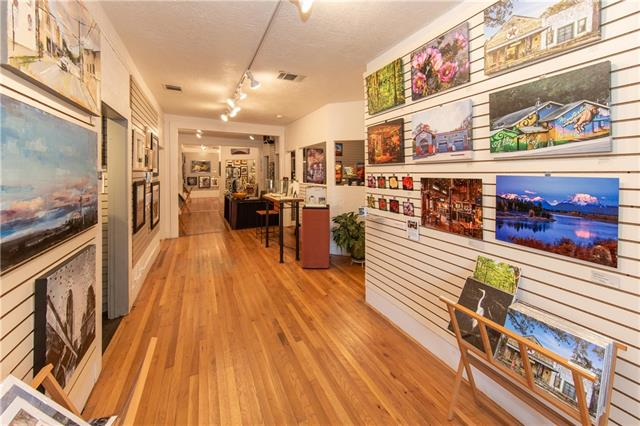 Charming Wimberley style building with large rooms in the 1-story building.  Work space and offices in the second 2-story building.