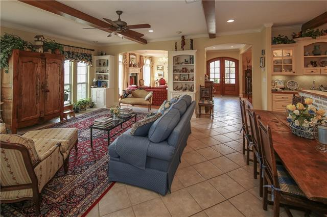 Breakfast area within Family Room and brick accented Island.