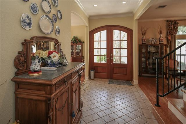 Entry area with beautiful Mahogany Front Doors!  Formal Dining Room on the Right.