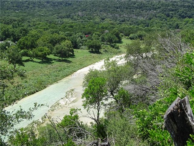 Looking down into the blue water of the Blanco River