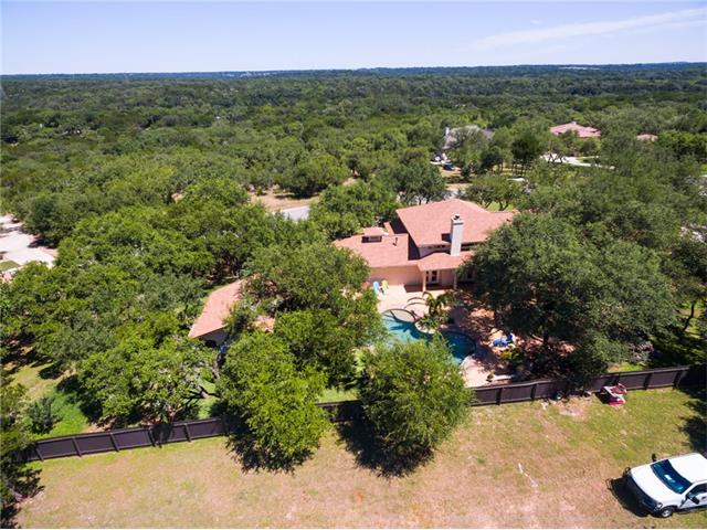 Aerial overlooking back of home to Hill Country