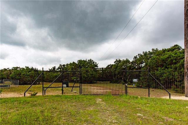 Entrance - Game fence along the front and back of property.