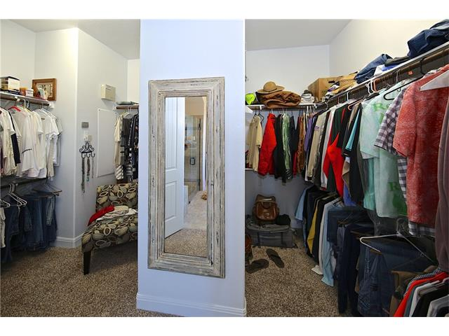 Large walk-in closet with his and her areas.