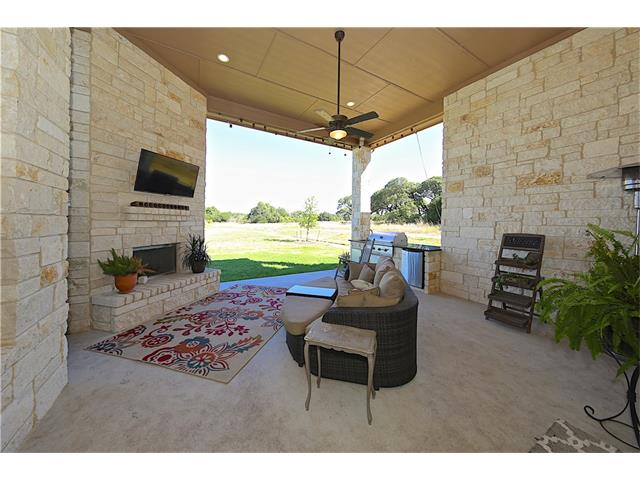 Extended patio area, fireplace, outdoor kitchen and outdoor speakers were all upgrades to this home.