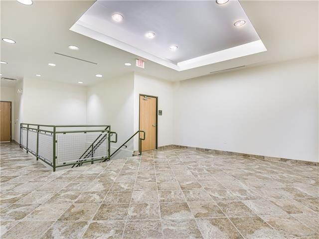 Door to Office and stairway. Elevators are to the right.
