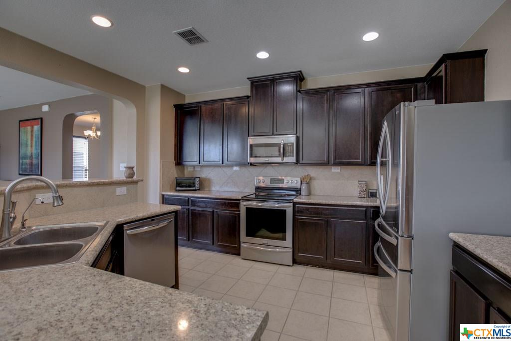 Open concept kitchen. Fridge included!