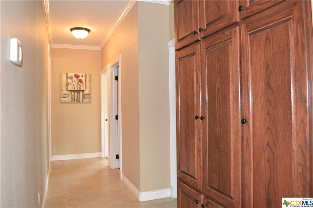 LOTS OF BUILT-IN STORAGE IN HALLWAY-BEDRMS-TO-LAUNDRY