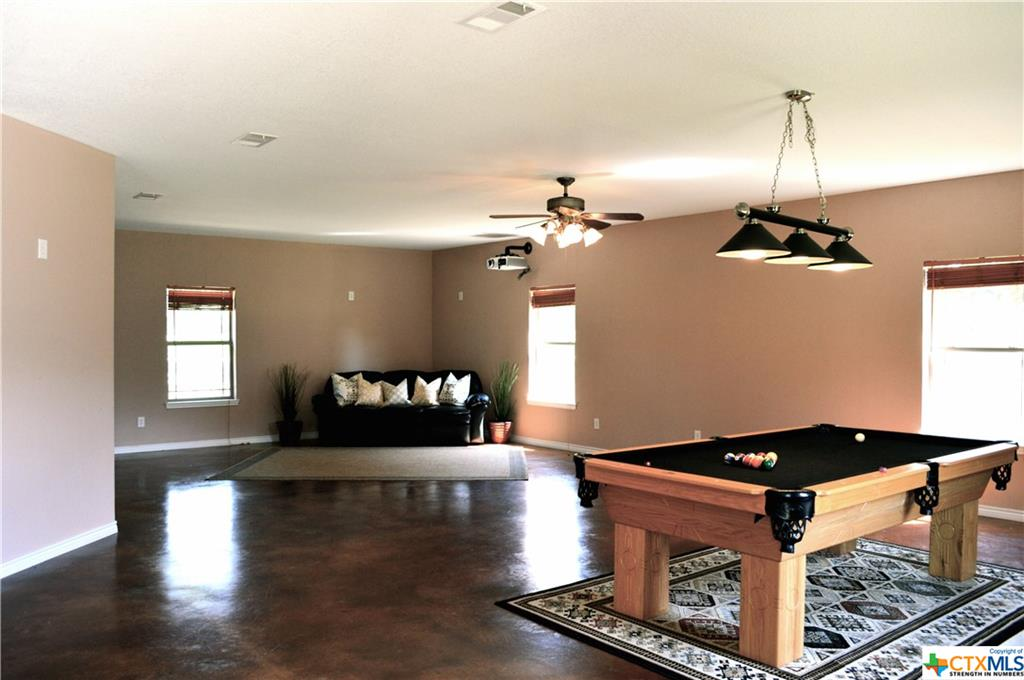 GUEST HOUSE-LIVING-POOL TABLE & PROJECTOR CONVEYS