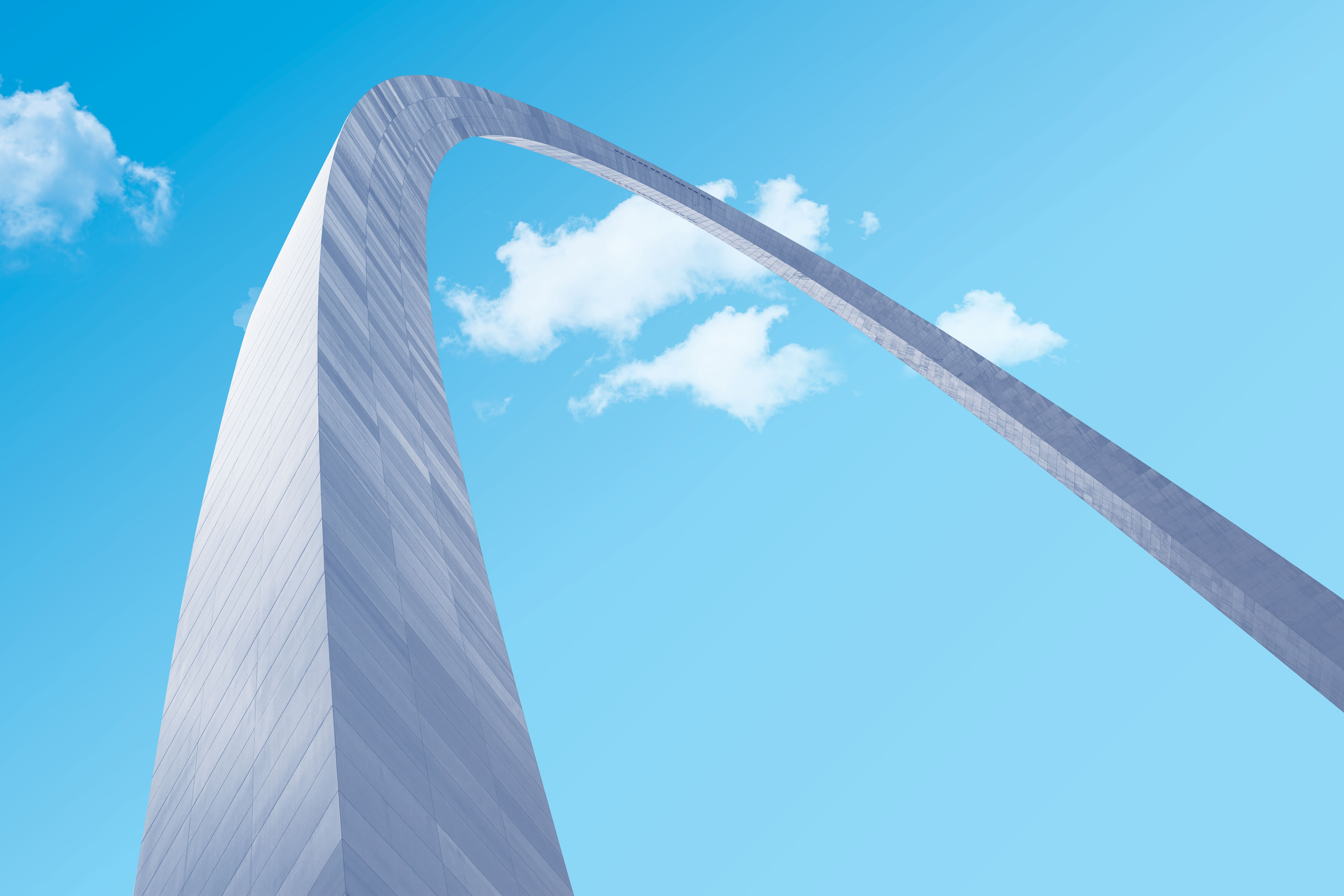 A picture of the St. Louis Arch taken from below against a clear blue sky.