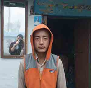 Man in Orange hoodie mobile