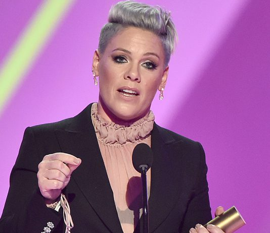 SANTA MONICA, CALIFORNIA - NOVEMBER 10: 2019 E! PEOPLE'S CHOICE AWARDS -- Pictured: Pink accepts People's Champion of 2019 award on stage during the 2019 E! People's Choice Awards held at the Barker Hangar on November 10, 2019