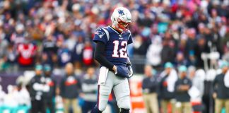 FOXBOROUGH, MA - DECEMBER 29: Tom Brady #12 of the New England Patriots looks on during a game against the Miami Dolphins at Gillette Stadium on December 29, 2019 in Foxborough, Massachusetts.
