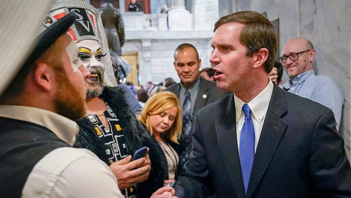 Andy Beshear hanging out with some drag queens