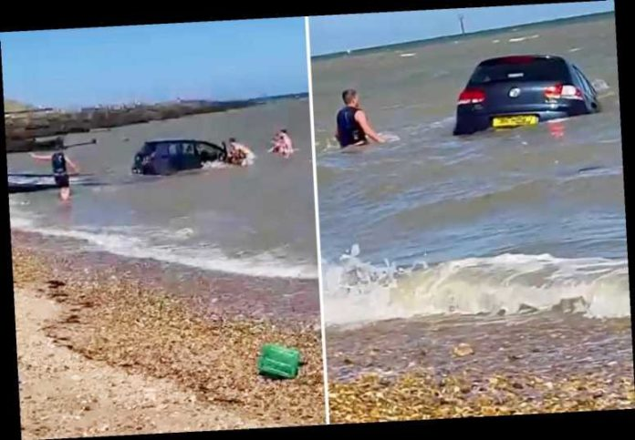 Moment devastated driver desperately tries to save VW Golf swept out to sea on Kent beach