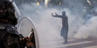 Protester facing tear gas