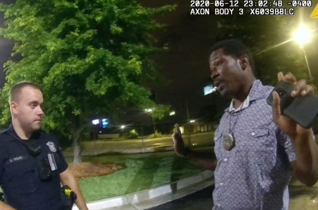 This screen grab taken from body camera video provided by the Atlanta Police Department shows Rayshard Brooks speaking with Officer Garrett Rolfe.Atlanta PD via AP