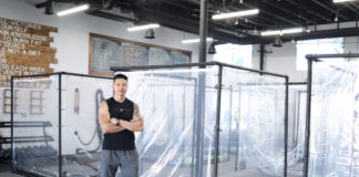 Pete Sapsin, owner of Inspire South Bay Fitness in Redondo Beach, stands in front of a pod made out of shower curtains and PVC pipe the gym will use to keep clients safe from the coronavirus. (Photo courtesy Pete Sapsin)