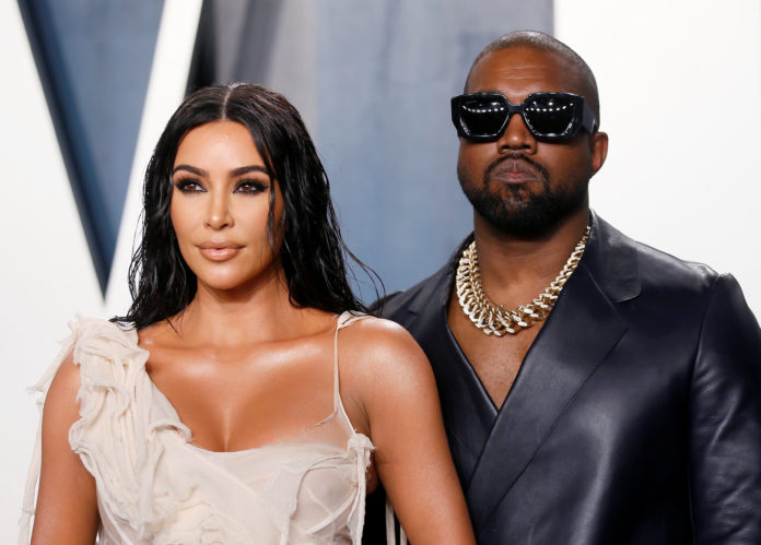 Kanye West posted a tribute to Kim Kardashian's new billionaire status, despite Forbes had stripped her off the title