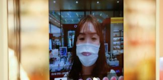 A woman wearing a mask to avoid the spread of the coronavirus disease (COVID-19) shops using AR make up at a cosmetic shop in a department store in Seoul, South Korea.Reuters