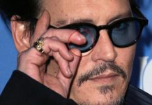 """Amber Heard says Johnny Depp wrote """"I Love You"""" with bloddy sliced finger"""