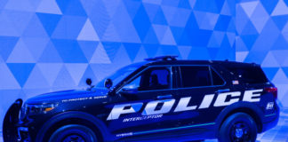 A 2020 Ford Explorer Hybrid Police Interceptor SUV at the North American International Auto Show Shutterstock