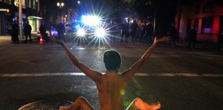 Naked Athena protests in front of Portland police