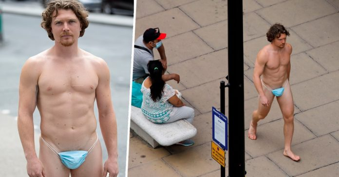 UK Man walks on street wearing nothing but a face mask as a G-string