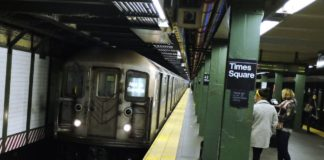 A 28-year-old woman was shoved onto the suway tracks of Times Square station in an unprovoked attack