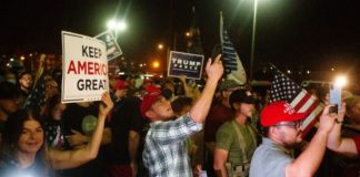 Trump supporters armed with rifles gathered in front of a voting building centre in Arizona to claim its shutdown