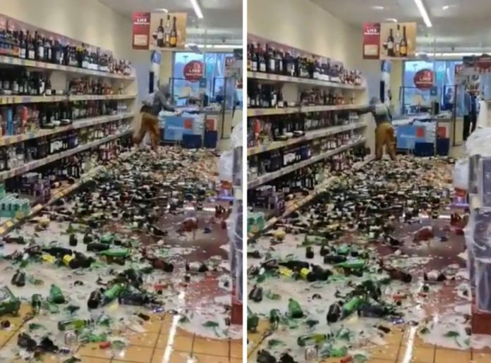 Woman loses it and smashes an entire alcohol aisle in a UK supermarket