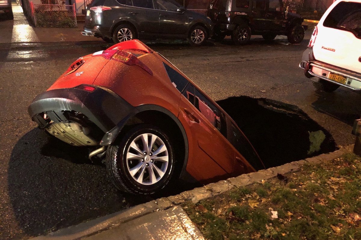 SUV swallowed by massive sinkhole in Queens