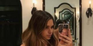 April Love Geary shows off baby bump in nude pic