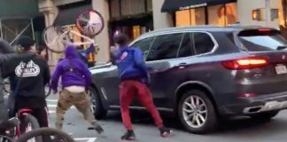 A pack of NYC bicyclists attacked a BMW SUV