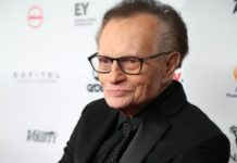 Larry King hospitalized with COVID-19